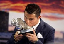 Cristiano Ronaldo kissing his all-time Real Madrid topscorer award during a ceremony at the Santiago Bernabeu stadium in Madrid, Spain on October 2, 2015. [Credit: AP Photo/Paul White]