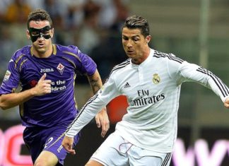 Real Madrid's Ronaldo tackling Fiorentina player with a mask