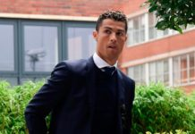 Cristiano Ronaldo rocks in suit looking calm