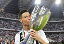Cristiano Ronaldo kisses his first Juventus trophy