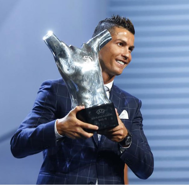 Ronaldo picks up the trophy after winning the UEFA Player of the Year