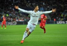 Real Madrid's Portuguese striker Cristiano Ronaldo celebrates scoring his second goal during the UEFA Super Cup football match between Real Madrid and Sevilla at Cardiff City Stadium in Cardiff, south Wales on August 12, 2014.