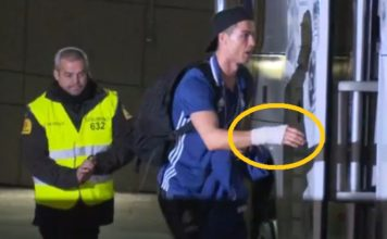 Cristiano Ronaldo with his bandaged right hand as he enters the Real Madrid bus.