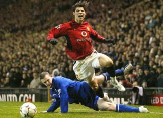 Cristiano Ronado tackled by Wayne Rooney