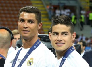 Cristiano Ronaldo and James Rodriguez with their 2017 UEFA Champions League winners' medals round their neck.