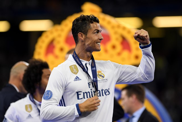 La Duodecima celebrations in Cardiff. Cristiano Ronaldo throws his fist up and holds his gold medal.