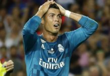 Cristiano Ronaldo holds his head in shock after referee Ricardo de Burgos' red card