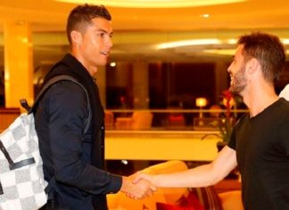 Cristiano Ronaldo is welcomed by Bernardo Silva at the Cidade do Futbol ahead of their World Cup qualifiers