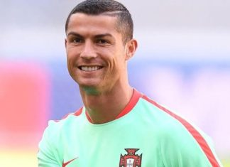 Cristiano Ronaldo shares a smile in training