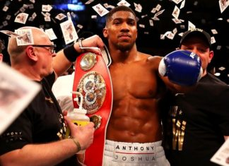 Anthony Joshua celebrates winning a boxing bout