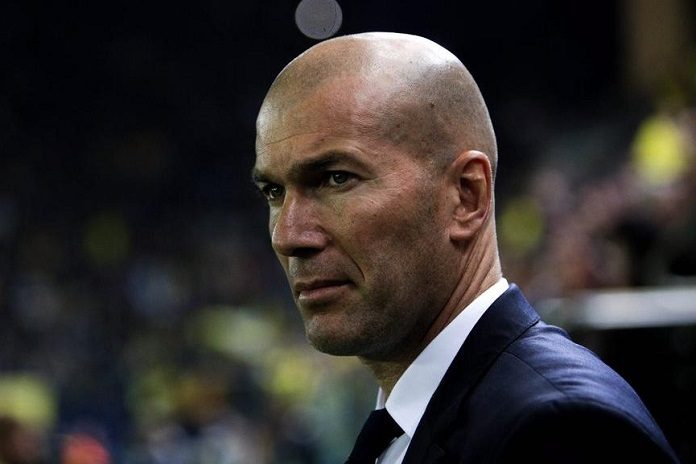 Zinedine Zidane watches Real Madrid game from the touchline.